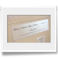 Hand crafted canvas table seating plan edged with lace